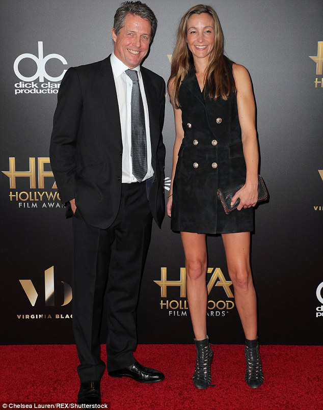 Hugh lucky boy: The ageing hunk had brought along his girlfriend Anna  Eberstein