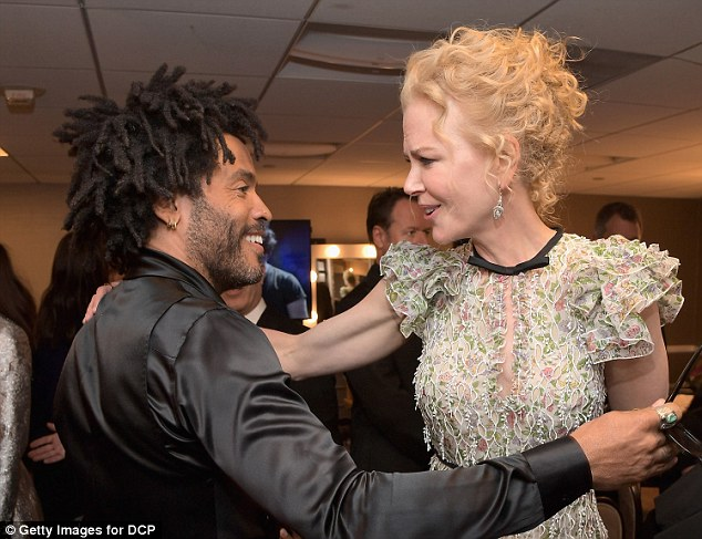 Hug it out: Nicole was also full of love for Lenny Kravitz as she wrapped him up in a hug