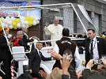 """Pope Francis waves as he rides in the popemobile through the Ecuadorean capital, Quito, on July 7, 2015. Pope Francis addressed 900,000 faithful who braved the cold and rain to hear him at an outdoor mass in Quito's Bicentennial Park. """"Fight for inclusion at all levels,"""" the pontiff said, pleading for """"dialogue"""" on the third day of a South American tour that will also take him to Bolivia and Paraguay.  AFP PHOTO / JUAN CEVALLOSJUAN CEVALLOS/AFP/Getty Images"""