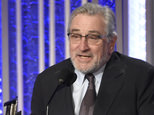 Robert De Niro included a plug for Hillary Clinton as he accepted his award (Invision/AP)