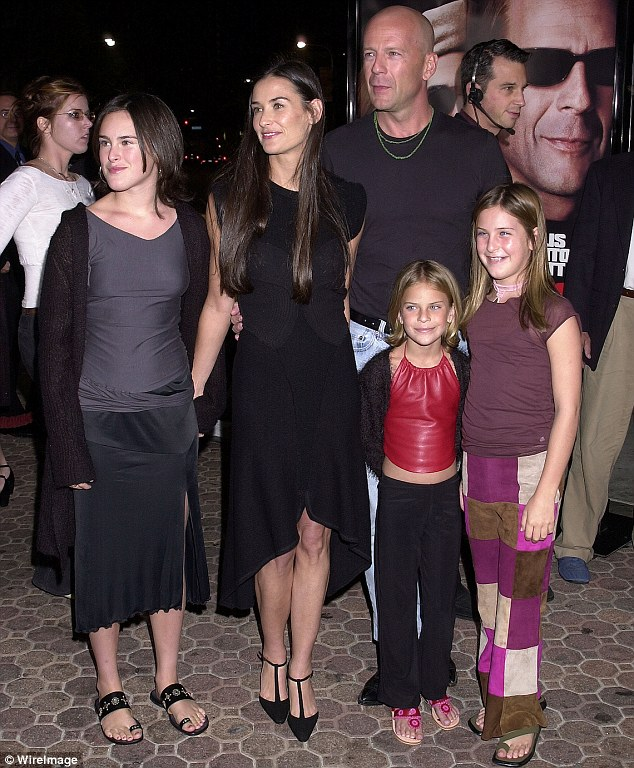 Happy family: She had three children with Bruce Willis before they divorced in 2000