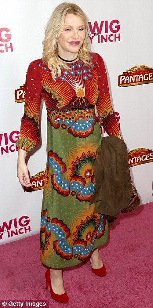 Rockin' up: Courtney Love wore an eye-catching maxi dress to the event, which depicted the volcano erupting