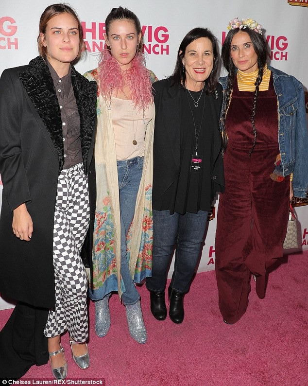 Family night out: Demi Moore looked overjoyed to be out with two of her daughters at a musical opening in Los Angeles on Wednesday