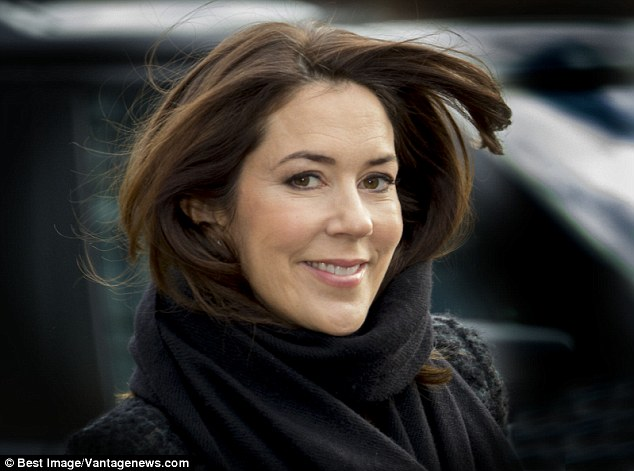 Stylish: The Australian-born royal smiled as she walked inside, her long hair tucked in to her scarf