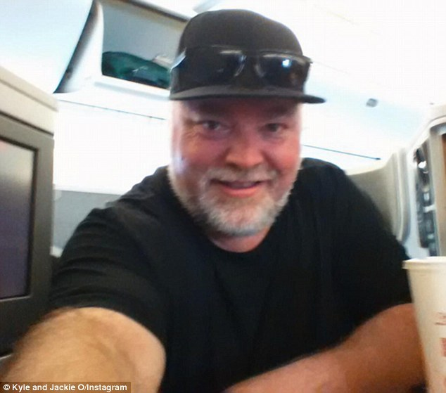 Disturbing:Kyle Sandilands has admitted he enjoys kicking back in his 'me room' and stare at paintings of himself while being naked