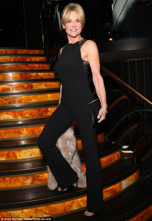 Figure-flautning fashion: Slipping into a fitted black jumpsuit for the event, held at famed London eatery Quaglino's, the 56-year-old looked nothing less than sensational