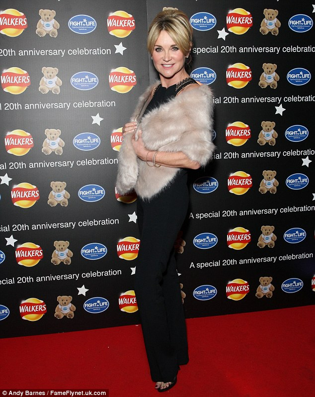 All wrapped up: Anthea teamed the flared jumpsuit with a pair of strappy stilettos, which only served to subtly define and accentuate her figure further, and a fur wrap