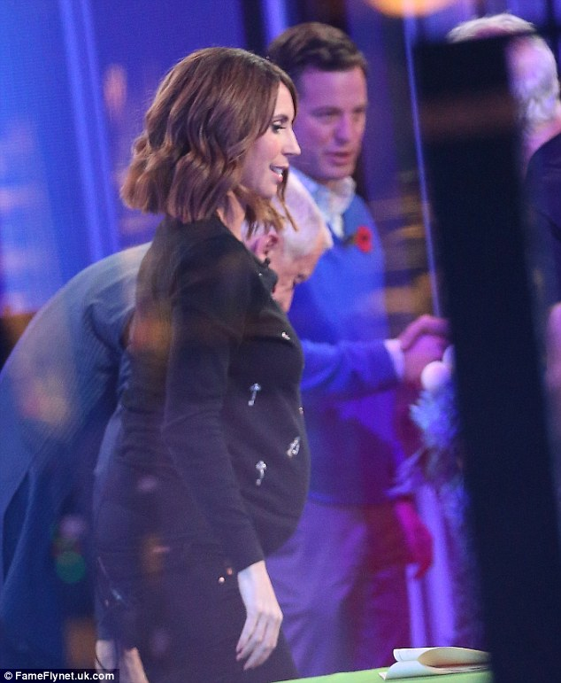 Looking chic! The presenter, 39, showed off her blossoming bump in fitted navy attire