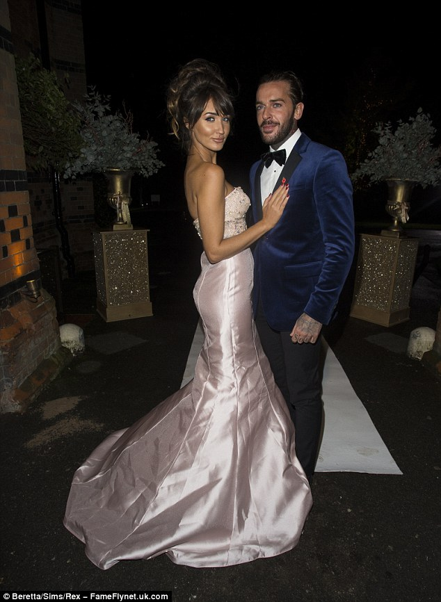 Brunette beauty:Sweeping her chestnut coloured locks into a chic chignon bun, Megan was a vision of happiness as he smiled at Pete, whilst he looked dapper in a navy velvet suit