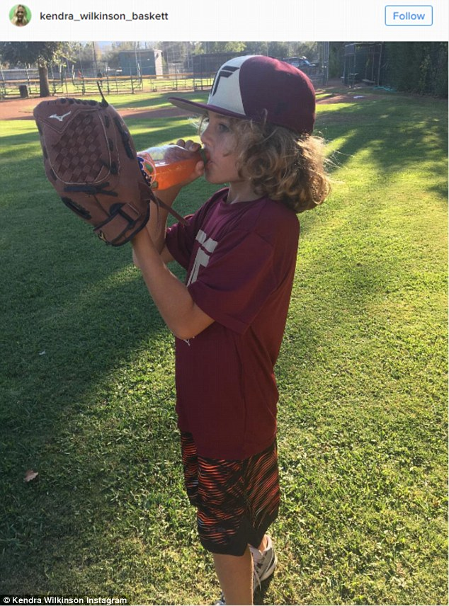 Getting it off her chest: Kendra affixed her long rant to this adorable image of her son on a baseball field