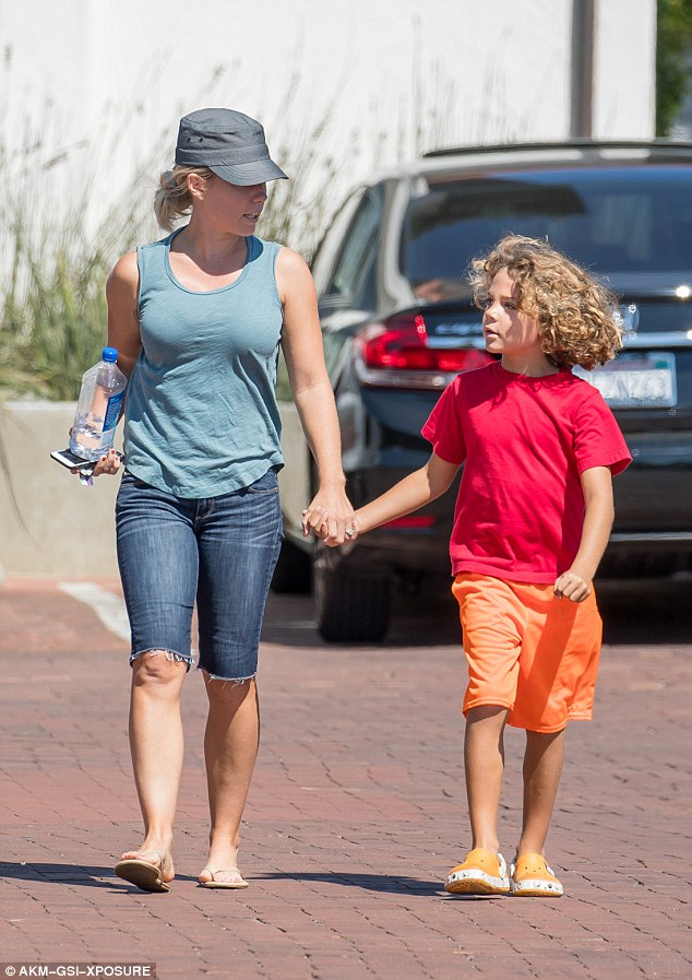 Mother knows best: Kendra said her son likes his hair shaggy and she's happy if he is. The two were pictured this past August in Malibu