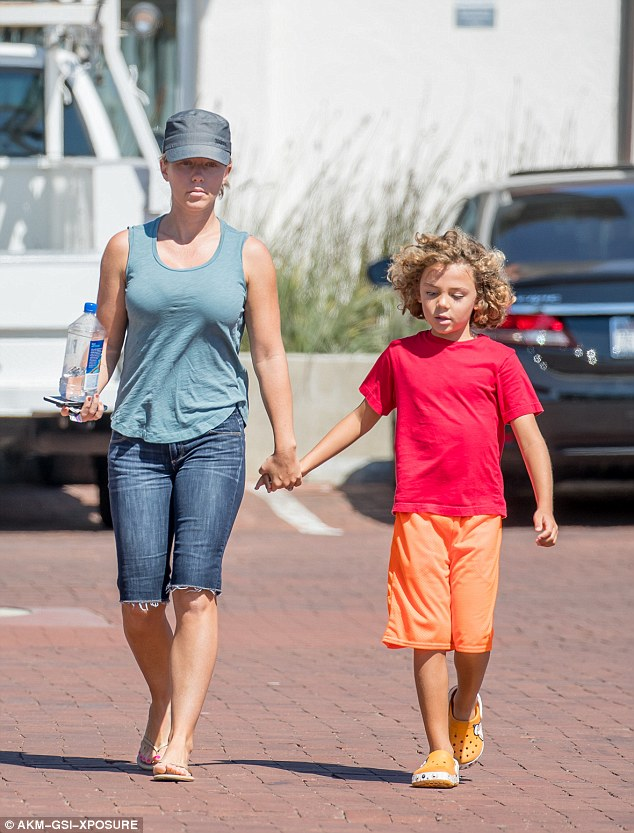 Uh-oh: Kendra said she faced a dilemma when her son asked to read her social media comments on Sunday, as she knew there was chatter about his look