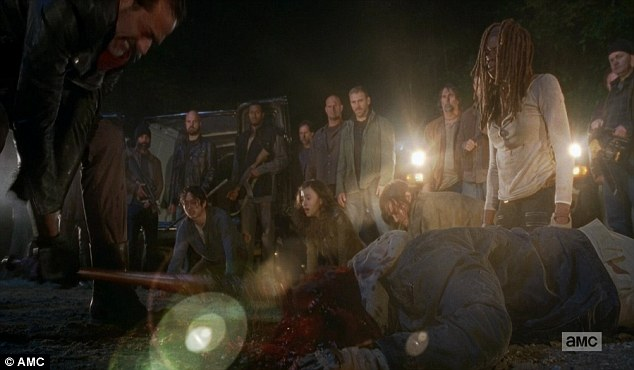 Zombie chow: In a stomach-churning premiere, Negan crushed both heroes' skulls in a brutal and sickening display of power
