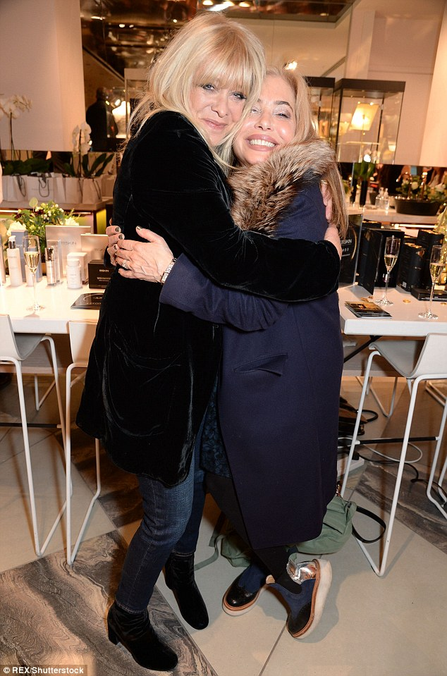 Blondes unite!  Jo Wood was another familiar face in the crowd, putting on a stunning display in jeans and a velvet coat