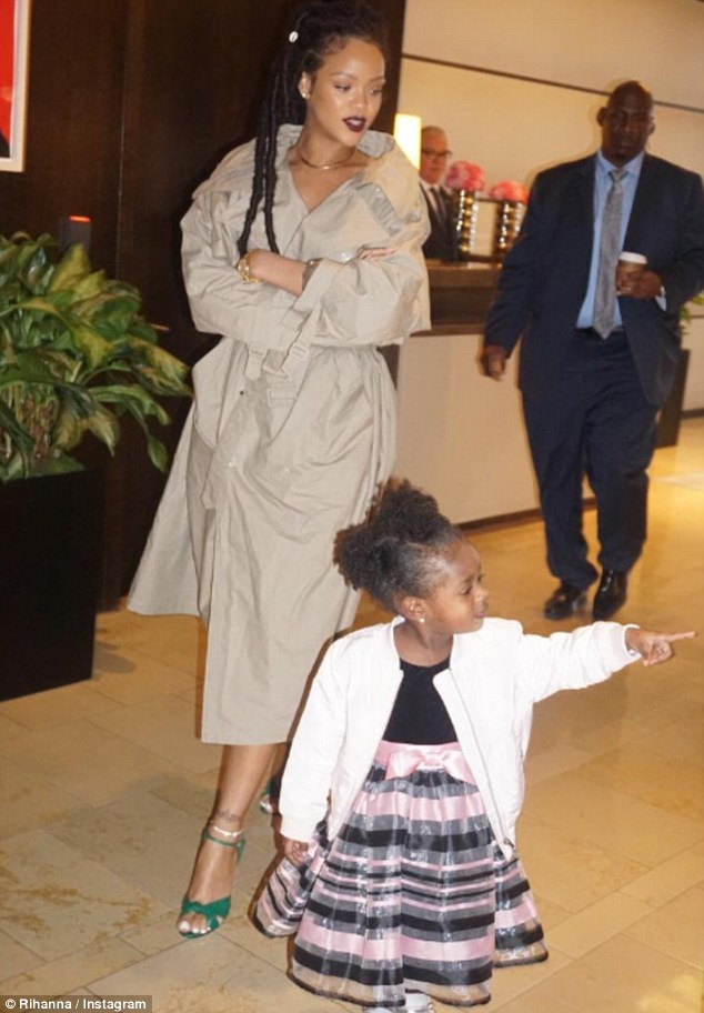 Taking the lead: Majesty, wearing her best party dress, walked in front of'Aunty OhNaNa,' who was covered up in a cream trenchcoat, as they left a hotel lobby