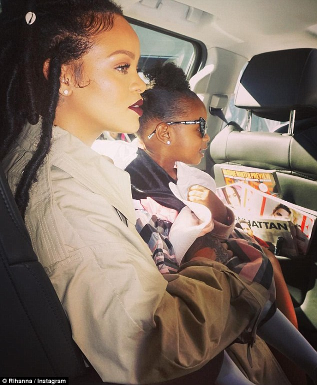 Picking up on celeb trends: A surprised Rihanna captioned this shot, taken in the back of a limo, 'She jumped in with sunglasses on' adding a little monkey emoji