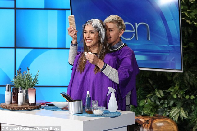 Teamwork: Using the old 'helping hands' improvisational game, the 58-year-old talk show host served as Jessica's hands as she read a funny teleprompter speech penned by Ellen