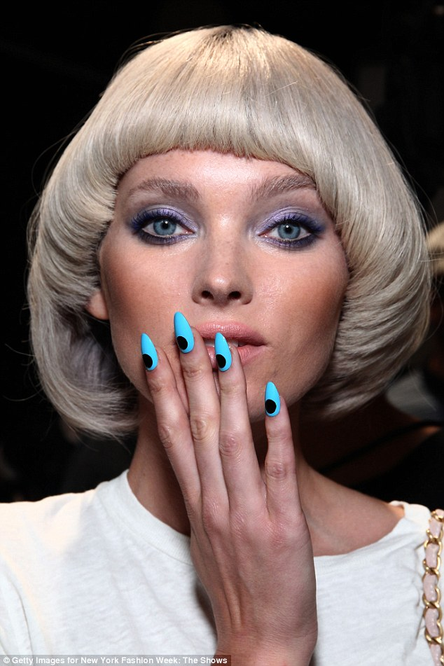 Don't you lilac it? Using MAC products, make-up artist Kabuki created colored smoky eyes for the Jeremy Scott runway show