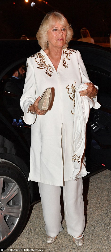 The Duchess of Cornwall stunned in an ivory coloured ensemble with gold embroidery
