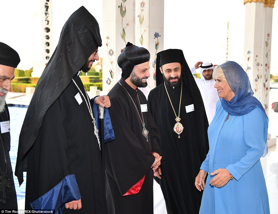 The Duchess engaged in an animated conversation with clerics at the Sheikh Zaved Grand Mosque