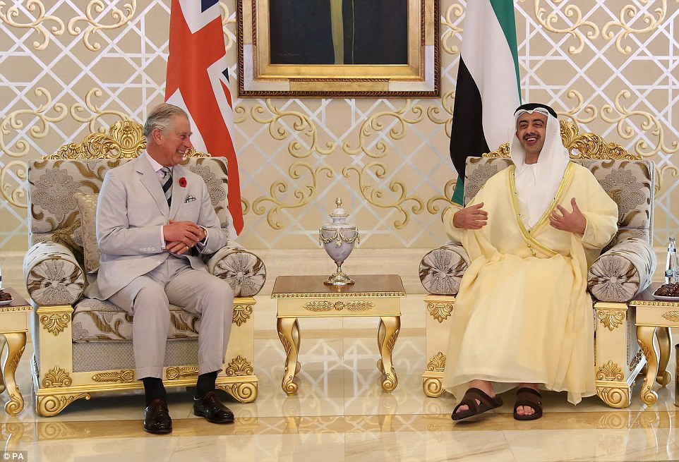 A laughing Prince Charles chats with Foreign Minister Abdullah Bin Zayed after arriving in Abu Dhabi