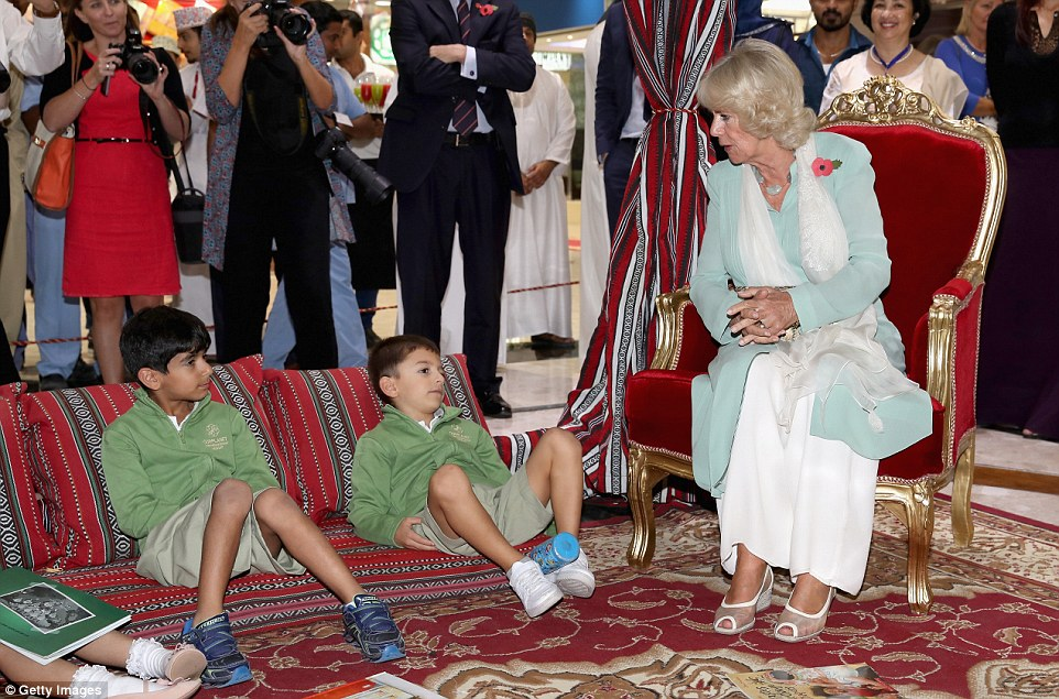 Camilla talks to children during a book reading outside Dar Al Atta Bookshop during the third day of her royal tour of the Middle East
