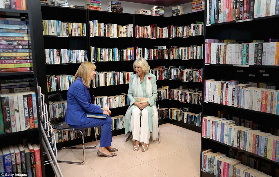 Camilla learns more about literacy initiatives at the Dar Al Atta Bookshop on the third day of a Royal tour of Oman