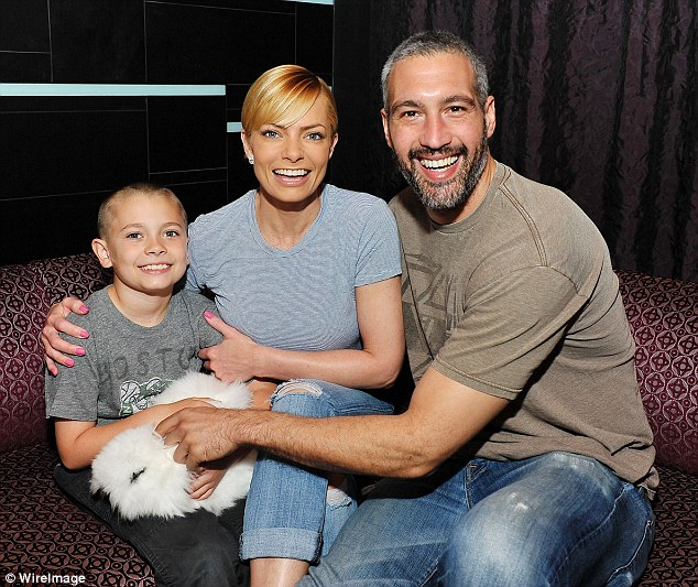 Pictured March 26: The North Carolina-born blonde has a nine-year-old son Dazi (with ex-fiancé DJ Eric Calvo), and she's been dating Lorin shoe store owner Hamzi Hijazi (R) since 2011