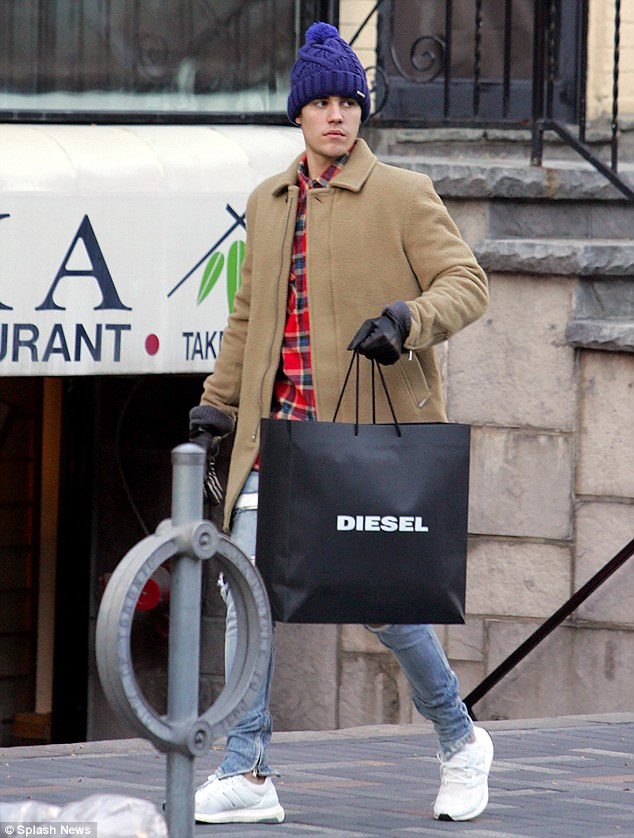 Solo: The hitmaker, who is enjoying some time off before returning to his Purpose World Tour on Tuesday, left Diesel with a large shopping bag