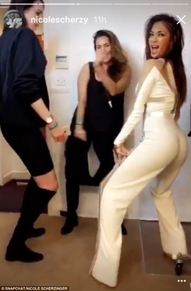 Time to celebrate! X Factor judge Nicole Scherzinger took the party backstage where she celebrated her boys' success with a spot of twerking on Sunday night