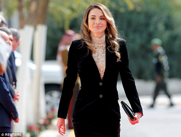 The mother-of-four opted for a classic black pencil skirt suit, adding a feminine touch with a lace detail blouse and loose curls