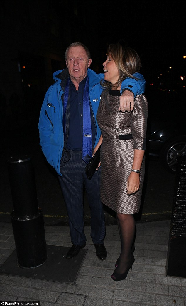Loved-up: The former Who Wants To Be A Millioniare? host wrapped an arm around his girlfriend as they arrived at the Radio One studios in London