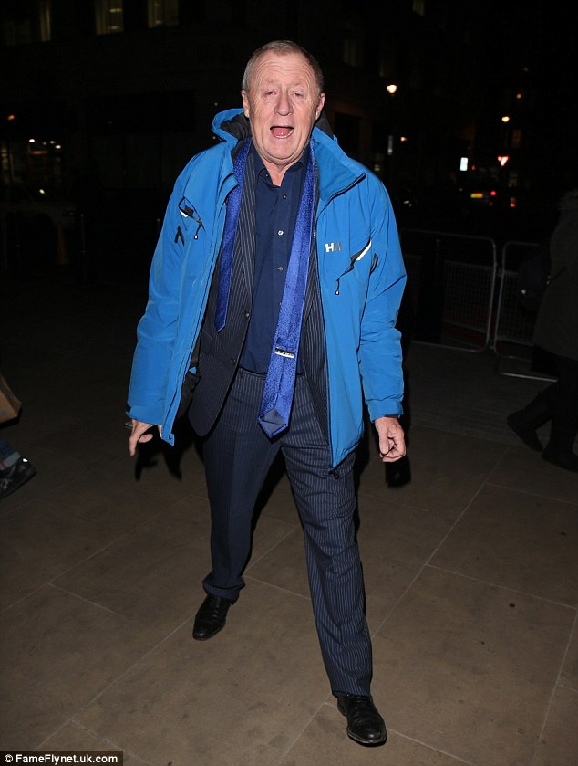 Keeping warm:The presenter wrapped up against the November chill in a blue padded jacket