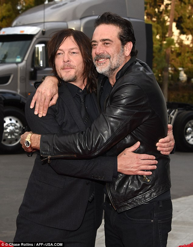Colleagues and buddies: Norman Reedus (left) and Morgan (right) also shared an embrace