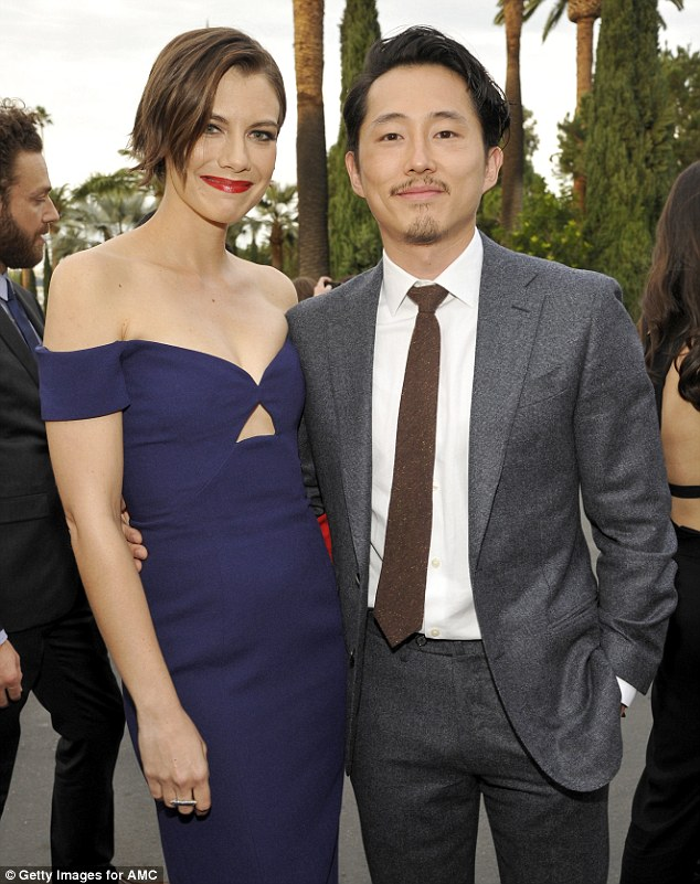 All smiles: Glenn his played by Steven Yeun (right), his pregnant widow Maggie Greene by Lauren Cohan (left)