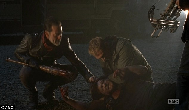 Dragged away: Daryl was dragged away before Negan punished the group for his defiance