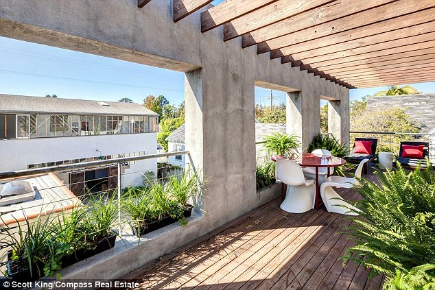 Perfect for al fresco dining: While it sits on a modest plot, the home has a spacious sunlit veranda for dining and entertaining