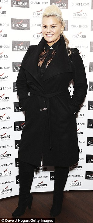 All black everything: Kerry Katona, 36, sported a stylish lace top with a chunky winter coat bizarrely layered on top