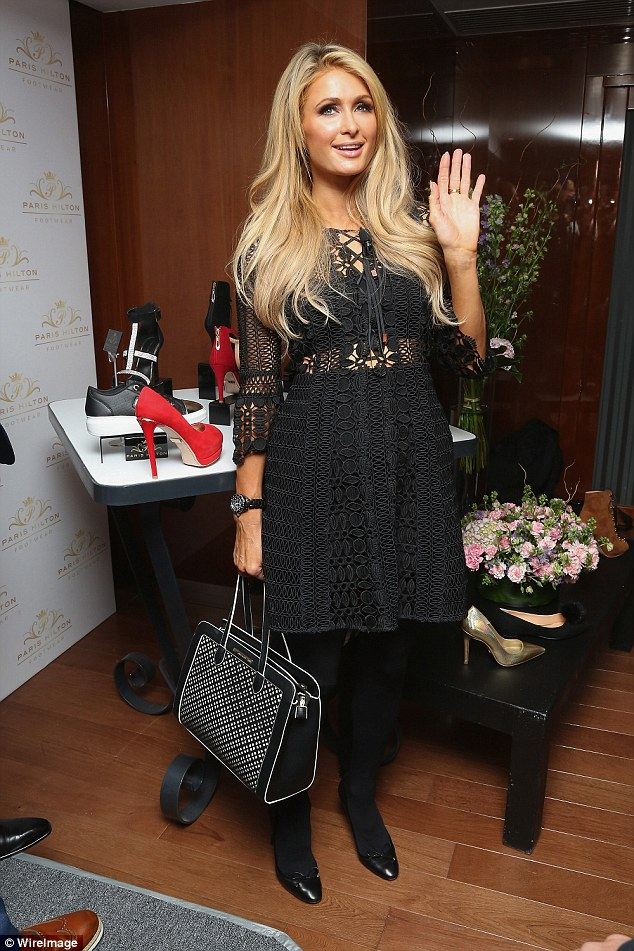 Her own creations: She paired her dress with opaque black tights, black shoes and a black and white handbag, both presumably from her own line