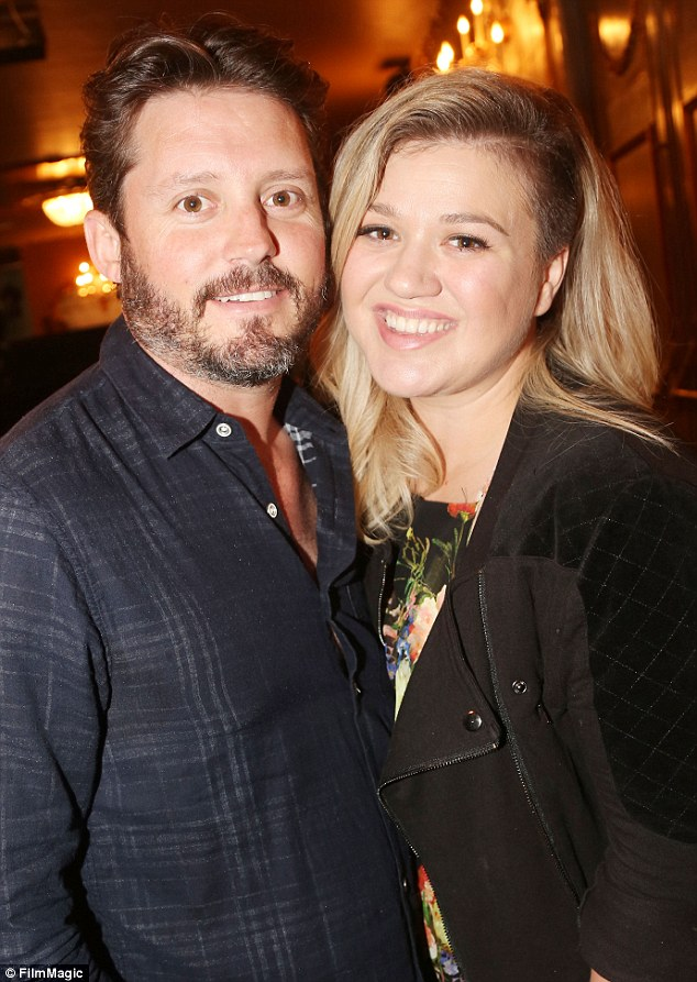 Husband and wife: Brandon and Kelly are pictured in New York on July 15, 2015