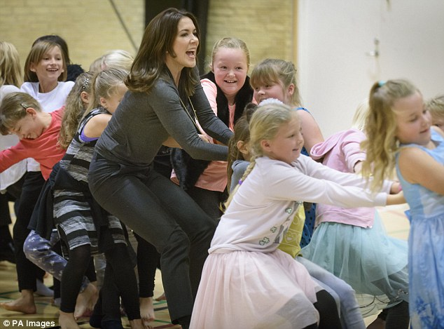 Princess Mary couldn't keep the smile off her face as she joined in playing tug-of-war and ball games