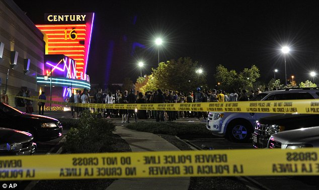 Crime scene: Bystanders gathered at the site of the shooting in the aftermath