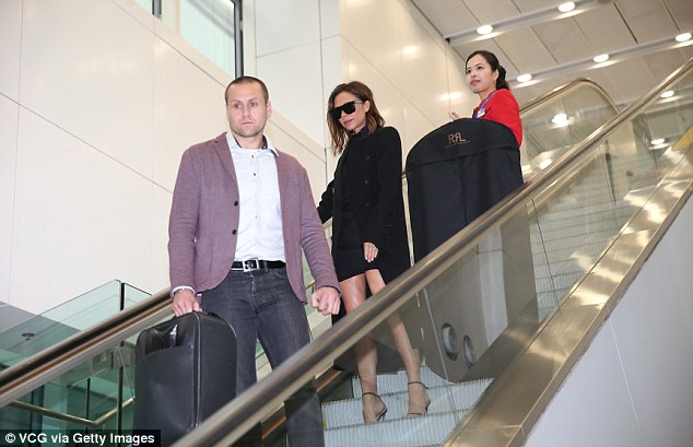Here she comes: The star was flanked by a burly businessman and a flight attendant