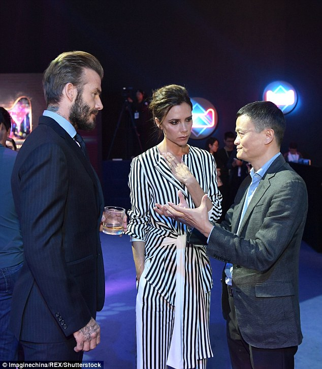 Looking good: Clad in a stripy jumpsuit from her with tie detailing at the waist bringing definition to the loose style, Victoria was the picture of elegance