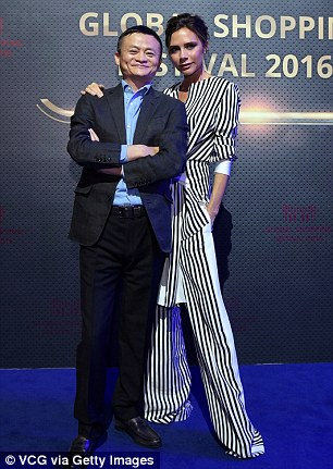 Say cheese: Both David and Victoria posed for photos with theAlibaba chairman during a dress rehearsal ahead of the 11.11 Global Shopping Festival