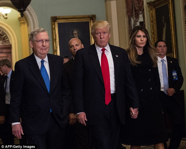 First couple: Melanie and Donald held hands as they walked alongsideMajority Leader Mich McConnell at the US Capitol