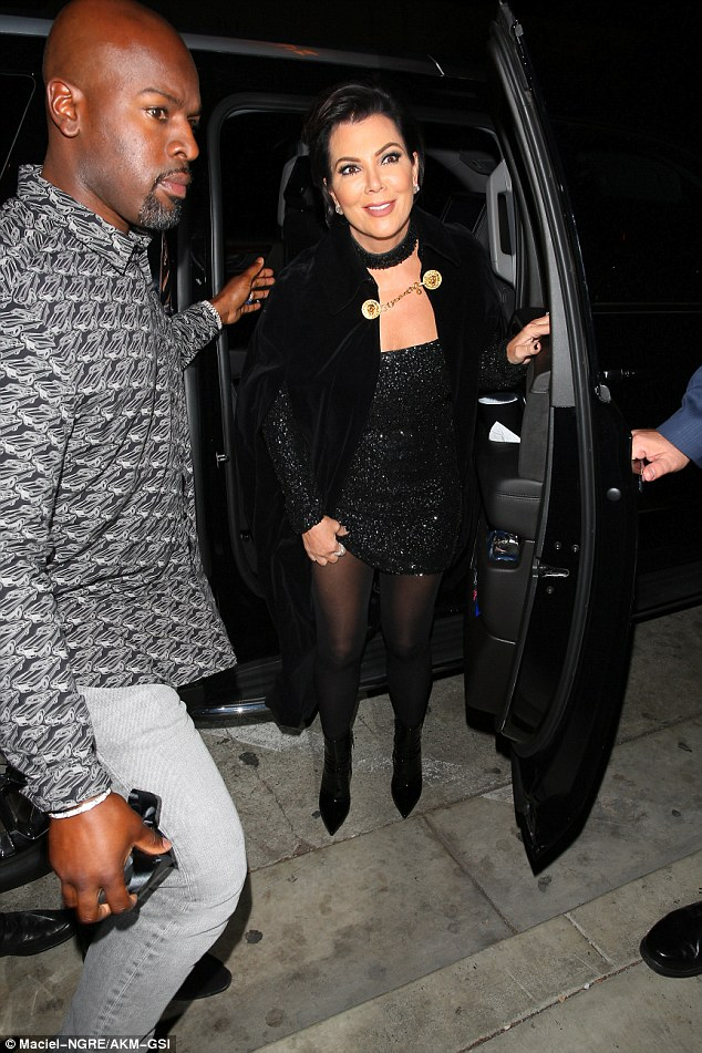 Someone's happy: Momager Kris Jenner, 60, however, did manage a smile as she arrived at the venue with boyfriend and bodyguard Corey Gamble at her side