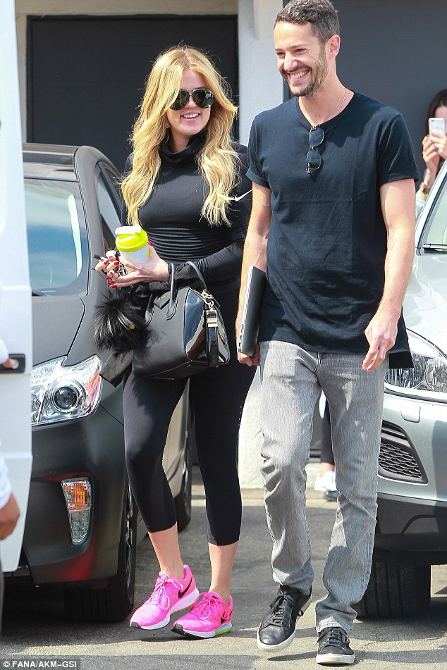 Who's that guy?: The E! queen was seen with an unidentified man as she exited the salon