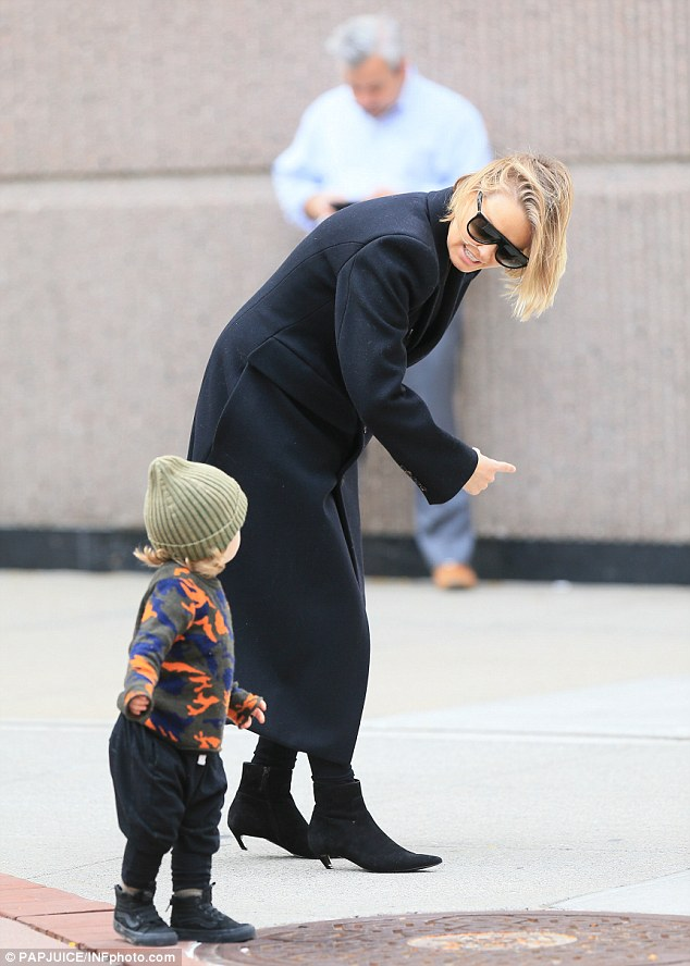 Precious:While out and about in New York, Lara appeared every inch the doting mother, holding onto Rocket's hand, and at one stage crouching down to check in on him