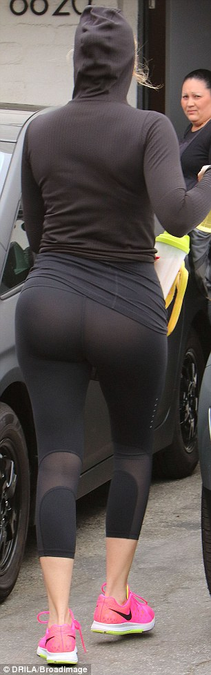 Sculpted: The star showed off her toned read and legs in a pair of very sheer athletic tights